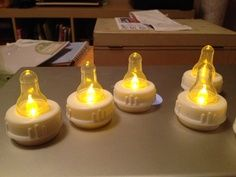 clear baby bottle nipples over electric flame tea lights