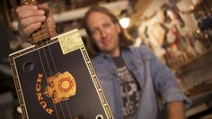 """Mike Snowden plays bluesy rock as a one-man band. But he's not playing a   Gibson Les Paul or a Fender Stratocaster -- his music comes from a guitar he   built from an empty cigar box.  """"I saw a ..."""