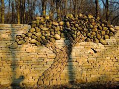 Dry stone wall with tree built by Eric Landman in memeory of his wife Kerry. Kerry Landman Memorial, Island Lake Conservation Area, Mono, On. Art Pierre, Garden Wall Art, Garden Gate, Walled Garden, Dry Stone, Metal Tree Wall Art, Wall Wood, Rock Wall, Stone Work