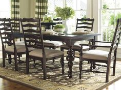 I find myself constantly liking Paula Deen's furniture. Love the legs on this! Not the chairs though.
