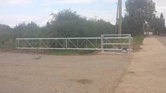 A traditional style farm cantilever style gate fully automated and installed near Spalding.