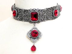 Red Gothic Choker - Gothic Jewelry - Victorian Swarovski Bridal Choker - Bridal Necklace - Red Wedding Necklace - Red Wedding Jewelry by https://www.etsy.com/shop/LeBoudoirNoir  A divine Victorian Gothic choker necklace to highlight a beautiful neck.  I joined five intricately detailed silver stampings, with rococo patterns, slightly bent to follow the curves of your neck and embrace it beautifully. A mesmerizing large octagon Swarovski crystal, which sparkles in any movem...