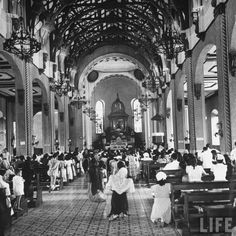 A view of a religious service in the Quiapo Church just before the outbreak of war with Japan. Location:	Manila, Philippines Date taken:	1942 Photographer:	Carl Mydans