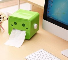 A tissue dispenser that'll make you smile even when you have a cold.   37 Things You Never Knew You Needed For Your Office