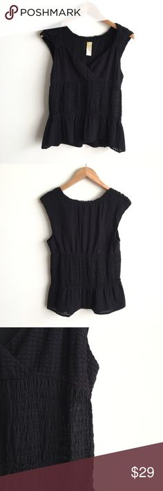 C.Keer Anthropologie Black Textured Sleeveless Top 93% nylon, 7% spandex.  Super stretchy, textured top.  Small crossover, v neckline.  Ruched middle.  Lined on the hem and bust.  Excellent condition; no flaws of signs of wear. Anthropologie Tops Tank Tops