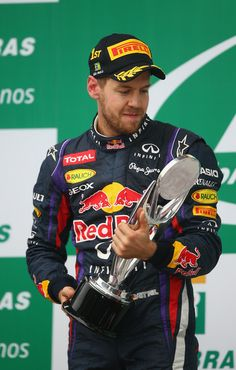 Sebastian Vettel Sebastian Vettel of Germany and Infiniti Red Bull Racing celebrates on the podium after winning the Brazilian Formula One G...