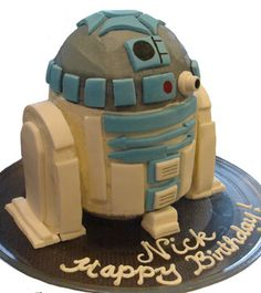 A step-by-step on how to make this cake...she made it look so easy... Would use frosting instead of fondant though. http://www.easy-cake-ideas.com/star-wars-birthday-cake-2.html