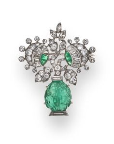 An art deco diamond and emerald brooch, French, circa 1925