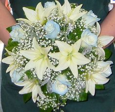 white asiatic lilies! maybe with some light blue daisies instead of roses?
