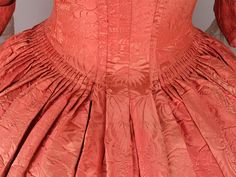Beautiful rosey damask dress. Look at that amazing pleating!  from At the Sign of the Golden Scissors