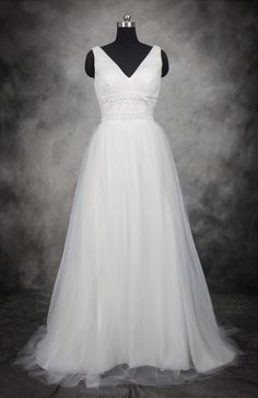 Pretty sleeveless tulle wedding dress, with an elegant ball gown shape! V Neckline And Back Waist Pearl Detail Tulle Wedding Gown Style Code: 11543 $159 Buy this wedding dress here: http://www.outerinner.com/v-neckline-and-back-waist-pearl-detail-tulle-wedding-gown-pd-11543-0.html #Wedding #WeddingDresses #OuterInner