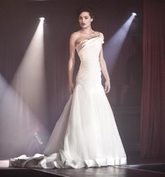 Abbey a stunning one shoulder organza fitted wedding dress with wide satin trims on bodice & hem now available at Pink Confetti
