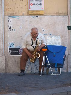 Definitely profound, street busking for a living in Rome, under a Bank Credit sign no less, and yes I gave some change to the fellow.  Rome, August, 2010.