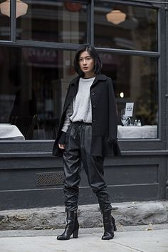 von vogue blogger leather pants leather joggers black leather pants winter outfits grey sweater black coat black boots