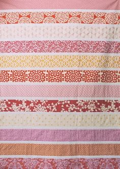 Love the style and color palette of this quilt. The polka dot back is also great.