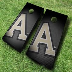 These officially licensed NCAA Army cornhole boards show off a black background with a slanted pattern that gives it a...