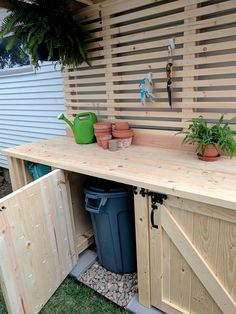Learn how to build the mother of all potting benches! This hefty potting bench has shelving for storage, two garbage can enclosures hidden behind doors, tons of work surface, slats for hanging tools, and a roof!