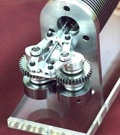 Stirling Engine Models. A fine example of a rhombic drive on a Beta type Stirling.