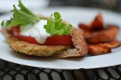 Chickpea Burger w/ Cucumber Tzatziki Sauce --- easy & yummy! Might add some garlic and mint to the sauce next time, though.