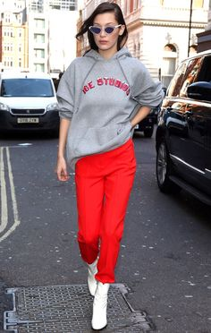Fashion Week 2017: Stars in London, Paris and Milan - Bella Hadid in a gray sweatshirt, red jeans and white booties