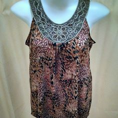 """Beautiful animal print sleeveless top size large Great sleeveless tank top. Animal print inspired. Body: 98% polyester, 2% spandex. Neckband: 95% polyester, 5% spandex. Tulle netted neckline with """"rope"""" detail & beads. No beads missing, but some could use reattached a little better. Tag says size large, but could also fit up to extra large. Any questions, just ask! Christopher & Banks Tops Tank Tops"""