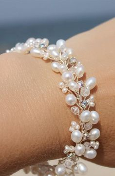 This delicate freshwater pearl bracelet was made to compliment my freshwater pearl and crystal stud earrings! I can would be happy to