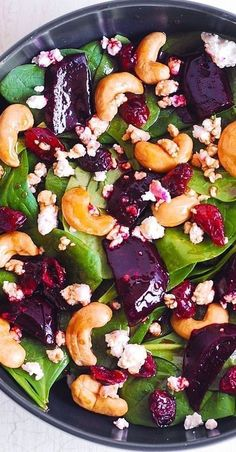 Beet Salad with Spinach, Cashews, Cranberries, and Goat Cheese with honey, lemon and olive oil dressing. Healthy, gluten free, Mediterranean-style salad, packed with fiber and nutrients. Goat cheese adds a touch of creaminess, while the cashews add a bit of crunch to this healthy beet salad. #beets #salad #beetsalad #healthy #healthysalad #spinach #cashews #cranberries #goatcheese #glutenfree #Mediterranean #recipe