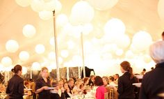 Oversized string light lanterns transform a tent
