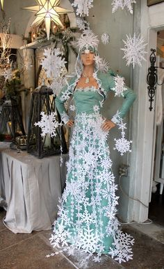 Noelle greeted us at the door... ...dressed in a spectacular gown of glittery sea-foam and pa...