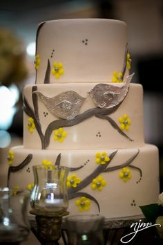 Silver and yellow bird wedding cake. love!  @A Legendary Event - Atlanta Floral, Decor and Catering