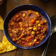 Simple Taco Soup Recipe -We first sampled this chili-like soup at a church dinner. It's a warming dish on a cold day. And since it uses packaged seasonings and several cans of vegetables, it's a snap to prepare. —Glenda Taylor, Sand Springs, Oklahoma