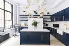 The kitchen is drop-dead GORGEOUS. Navy cabinetry and brass hardware... and check out that subway tiling in a surprising herringbone pattern!