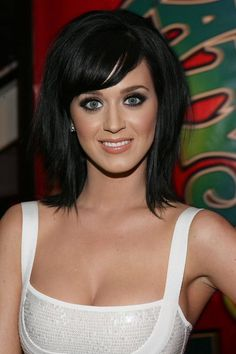 bob haircut with bangs-- would be good for Mom; low upkeep, can be sleek or messy chic.