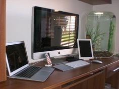 """iPad 2, Macbook Air 13"""", iMac 27"""", iPhone 4, and other accessories. Get rid of the aquarium and I love it. My birthday is in a few months... Anyone? ;)"""
