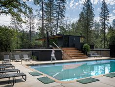 Anacapa Architecture and Geremia have designed AutoCamp Yosemite, a luxury campsite with trailers, tents and cabins filled with upscale decor. Outdoor Swimming Pool, Swimming Pools, Santa Barbara Hotels, Tent Awning, Yosemite Camping, Natural Pond, Canvas Tent, Luxury Tents, Rural Retreats