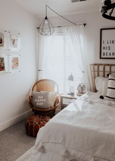 Feb 5, 2020 - boho modern beiges and whites with bamboo headboard and gallery wall master bedroom. Beautiful farmhouse chandelier