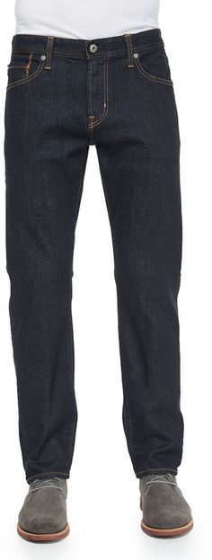 "AG Adriano Goldschmied ""Graduate"" fit jeans with contrast topstitching. Five-pocket style. Leather logo patch at back waist. Slim, straight legs. Button/zip fly; belt loops. Cotton/polyurethane. Made in USA of imported materials. Brand: AG Adriano Goldschmied Retailer: Bergdorf-Goodman Similar Item Here  Price : 168.00$"