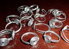 Tutorial:  making your own adjustable rings; you can also glue an embellishment onto the spiral.
