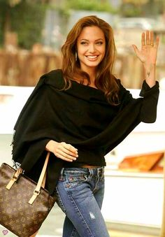 Angelina Jolie before she got too thin, she looks lovely with a bit more meat on her, plus she's carrying one of the coolest LV bags ever created...