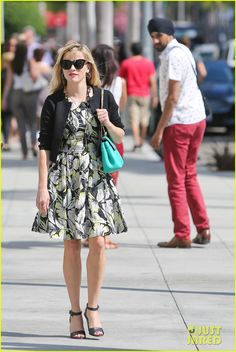 Reese Witherspoon's hair blows in the wind while heading to Prada for a quick retail therapy session on Thursday afternoon (August 7) in Beverly Hills, Calif.