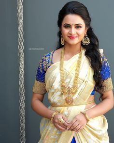 Janani Ashok in a bridal look in a blue color saree, elbow length sleeves blouse design, long chain, hip chain and jewelry Beautiful Girl In India, Beautiful Saree, Beautiful Indian Actress, Ghagra Saree, Saree Dress, Lehenga, Cotton Saree Blouse Designs, Bridal Blouse Designs, Saree Look
