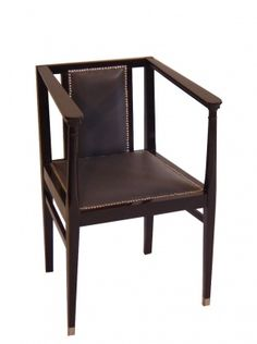 Armchair, Austria, c. 1915. Black stained beechwood frame; seat upholstered in gray leather; chromed sabots and rivets.