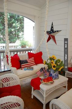 So neat! - patriotic porch! I really like the red against the white.. | CHECK OUT MORE PORCH AND SCREEN DOOR IDEAS AT DECOPINS.COM | #porch #porches #screendoor #screendoors #outside #exterior #homedecor #porching