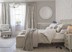 Love this Laura Ashley inspired Bedroom. These Grey tones are great if you want something elegant and modern. Plus check out that ottoman and bed frame!