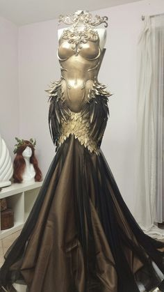 She was a dazzling display of terror in a solid gold bodice decked with feather-like razors. Yet the auburn fabric trailing behind her reminded the people of her grace and femininity; that did t stop them from bowing to the ground when her name was barely whispered. She was both Valkyrie and queen, and she ruled the world.