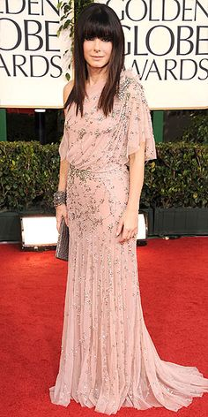 Sandra Bullock's Style Evolution | WITH A BANG | She (surprise!) debuted a dramatic do to go with her sweet blush Jenny Packham gown and coordinating gunmetal accessories.