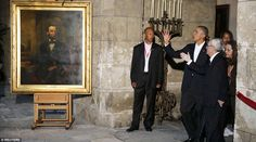 U.S. President Barack Obama stands near a portrait of Abraham Lincoln rolled out just for ...