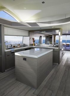 Hatteras 70 Motor Yacht: The standard galley has excellent views fore and aft, as well as out both sides, and is well illuminated by the windows overhead.