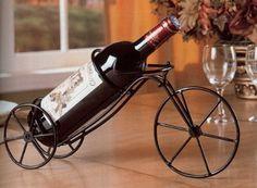 "900033 Black wrought iron metal single bottle bicycle wine r.- 900033 Black wrought iron metal single bottle bicycle wine rack Black wrought iron metal single bottle bicycle wine rack, welded solid no parts move. Measurements: 15 "" x 3 x 7 H SKU -"