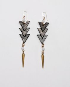 Hunting Earrings    Candace Ang vs. Margarita Saplala    Beaded tribal earrings from Candace Ang. Features three tribal style beads linked and attached to a long dagger charm with gold fittings.    $66.00